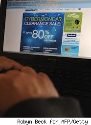 man looks at Cyber Monday sale online
