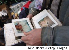Woman looks through photo album