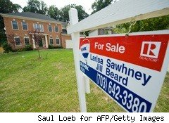 for sale sign outside brick home