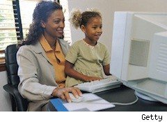 a mommy blogger and her child sit at the computer and blog