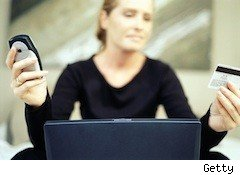 worried lady with phone and laptop - credit score