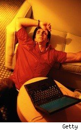 a young man is exhausted by his laptop - daily deal fatigue