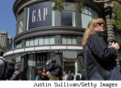 Woman walks past a Gap store in San Francisco