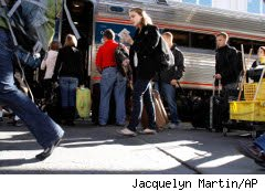Holiday travelers boarding trains