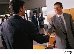 men shaking hands - good economic news