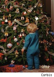 little kid looking at a christmas tree - kids' expectations