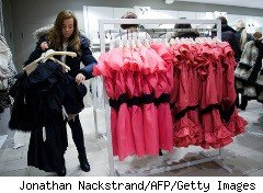 Woman shops for cocktail dresses at H&M