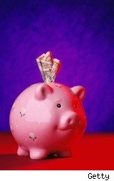 piggy bank stuffed with cash - savings