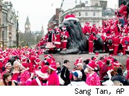 Flash Mob of Santas; flash mobs are a fading fad.
