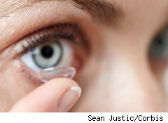 Woman putting in her contact lenses