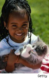 Little girl with her pet kitten