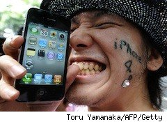 young man very happy with his iphone - verizon iphone
