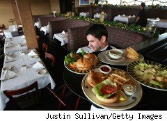 Restaurant waiter delivers a tray of food
