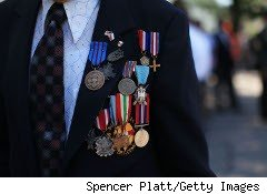 Veteran displahys his medals
