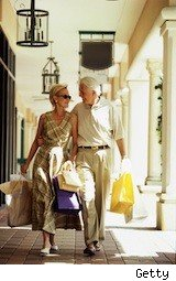 older man and woman shopping - desired brands