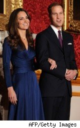 Prince William and Kate Middleton pose for photographers as they announce plans for a royal wedding