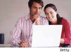 a couple watches a movie on a laptop - facebook movie rentals