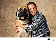 Boy with dog that could be protected with a pet trust fund