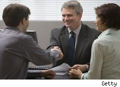 a man shakes a hand - temp job tips