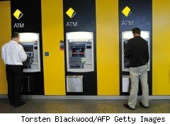 People using ATMs