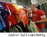 man ponders shirts at thrift store - what to buy in April