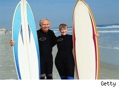 retired couple with surfboards - social security