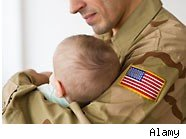 Soldier holding baby