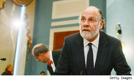 Former MF Global Chairman and CEO Jon Corzine (C) and his attorney Andrew Levander