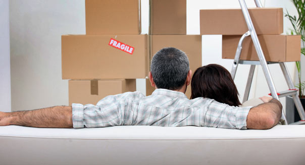 Couples moving in together in an apartment