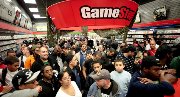 People wait to pick up their copy of Modern Warfare 3 in New York, U.S., on Monday, Nov. 7, 2011. Photographer: Stephen Yang/ Bloomberg News