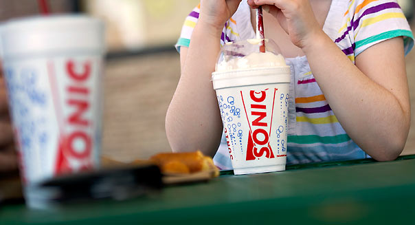 Avery Feek, 4, sips a vanilla milkshake at a Sonic Drive-In restaurant in Normal, Illinois, U.S., on Tuesday, March 20, 2012. Photographer: Daniel Acker/Bloomberg *** Local Caption *** Avery Feek
