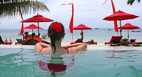 KOH PHANGAN THAILAND - JUNE 18:  A woman enjoys the beachside pool at the Anantara Rasananda resort  June 18, 2012 on the island of Koh Phangan off the coast of Koh Samui . Thailand's official tourism body, the Tourism Authority of Thailand (TAT) has set itself the ambitious target of attracting more than 20 million tourists in 2012. According to TAT, In April, Thailand welcomed 1,659,021 international tourists which is a slight increase of 6.87% over the same in 2011.  (Photo by Paula Bronstein/Getty Images)