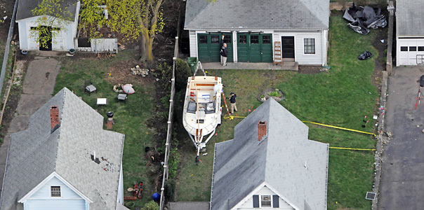WATERTOWN - APRIL 20: An aerial view of the boat where Dzhokhar A. Tsarnaev was found hiding after a massive manhunt is seen in the backyard of a Franklin Street home April 20, 2013 in Watertown, Massachusetts. Tsarnaev was taken into custody after a daylong manhunt that began when he and his brother, and co-conspirator in the Boston Marathon bombing, killed a Massachusetts Institute Of Technology police officer and wounded another in Cambidge. Dzhokhar Tsarnaev then car jacked a vehicle and fled into Watertown where another shootout accurred. Tsarnaev's brother Tamerlan was killed in the Cambridge shootout. (Photo by Darren McCollester/Getty Images) *** Local Caption ***