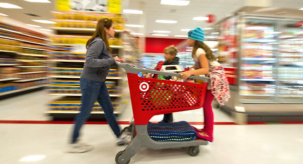 A family shops for grocery food at Target