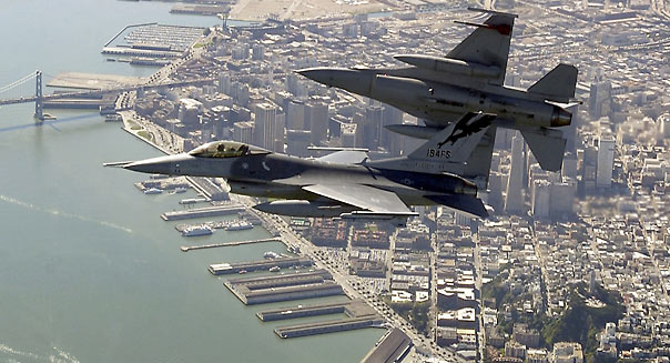 OVER SAN FRANCISCO BAY - MARCH 16:  In this handout image provided by the U.S. Air Force, two F-16 Fighting Falcons begin to roll into position for a rapid descent during an Operation Noble Eagle training patrol March 16, 2004 over the San Francisco Bay, California. The F-16s are assigned to the California Air National Guard's 144th Fighter Wing in Fresno, California.  (Photo by Lance Cheung/U.S. Air Force via Getty Images)