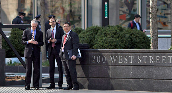 Pedestrians walk by Goldman Sachs headquarters in New York, NY, Monday, April 15, 2013.