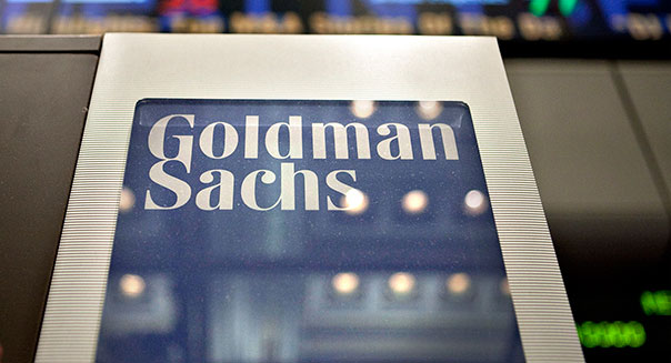 A Goldman Sachs Group Inc. logo hangs on the floor of the New York Stock Exchange in New York, U.S., on Wednesday, May 19, 2010. Goldman Sachs Group Inc. racked up trading profits for itself every day last quarter. Clients who followed the firm's investment advice fared far worse. Photographer: Daniel Acker/Bloomberg via Getty Images