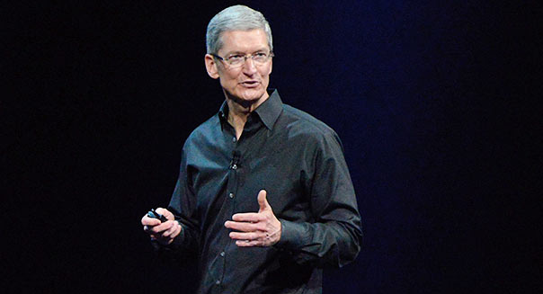 Tim Cook, chief executive officer of Apple Inc., speaks during the keynote of the World Wide Developers Conference (WWDC) in San Francisco, California U.S. on June 10, 2013. Apple Inc. is preparing to unveil sweeping changes to the software powering iPhones and iPads, seeking to reignite desire for its products and blunt the advance of Google Inc.'s Android mobile operating system. Photographer: David Paul Morris/Bloomberg