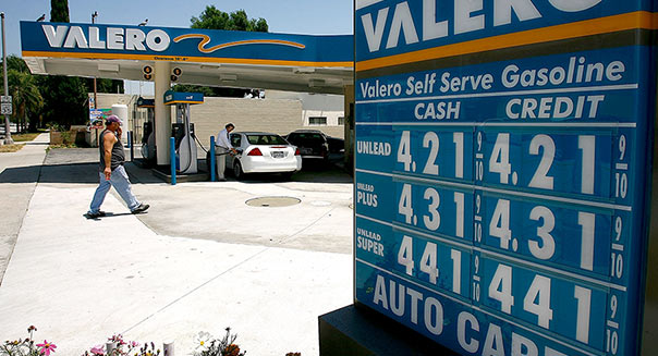 PASADENA, CA - MAY 30: A driver fills up at a Valero gas station in an area where the price of a gallon of a gallon of gas typically ranges from as low as $4.20 to more than $4.50, and diesel sells for more than $5.00, on May 30, 2008 in Pasadena, California. As fuel prices continue to hit near-daily record highs, the average price for a gallon of regular for the rest of the nation is expected to surpass the four-dollar mark in within days. (Photo by David McNew/Getty Images)