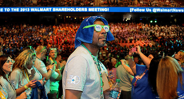 David Glasgow, of Virginia, looks up to the crowd before the start of the 2013 Walmart Shareholders Meeting at Bud Walton Arena in Fayetteville, Ark Friday June 7, 2013.