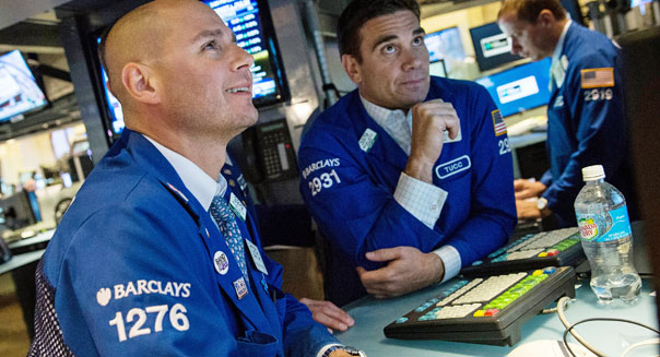 new york stock exchange traders wall street earnings economic data
