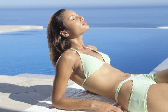 woman-sunbathing-skin-cancer