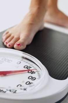 woman-on-bathroom-scales-weight