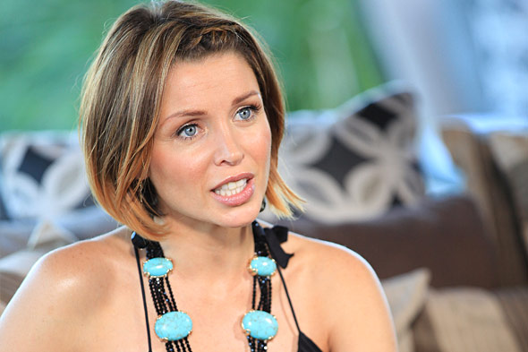 Dannii Minogue with blue and black necklace