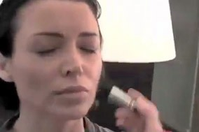 Dannii Minogue with makeup brushes