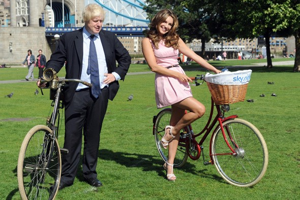 Boris Johnson and Kelly Brook with their bikes outside City Hall