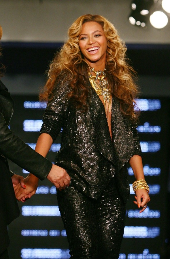 Beyonce lights up the House of Dereon catwalk with her baby bump - and her mum
