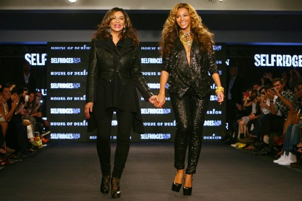 Beyonce lights up the catwalk with her baby bump and her mum