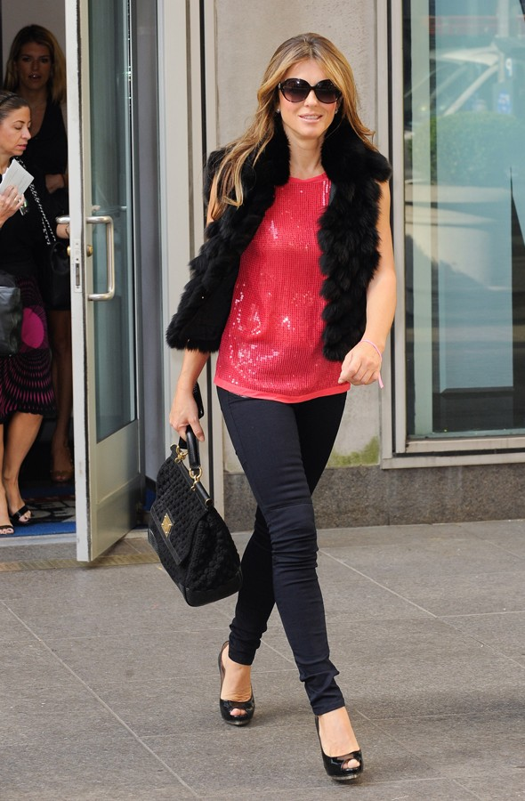 Liz Hurley hits the Wendy Williams show in a pink sequin top and gilet