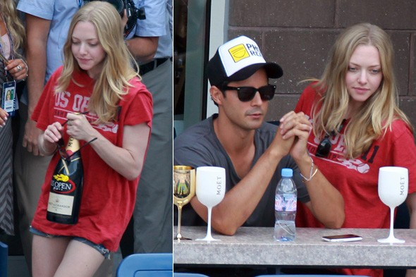 Amanda Seyfried watching the tennis with a friend.